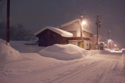 walking at night in heavy snow.